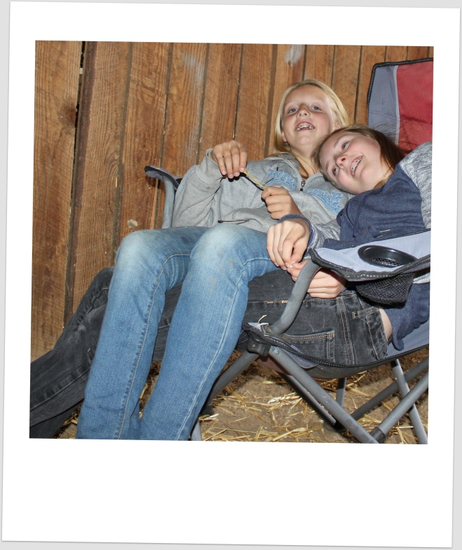 E. and J. relaxing in the barn.
