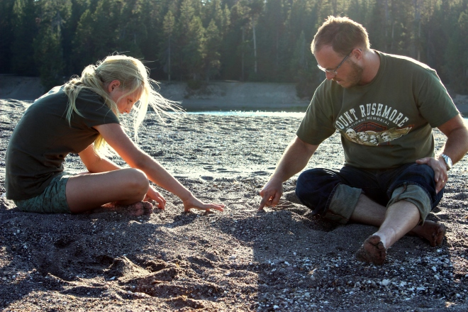 Yellowstone: J. and M. play games with pebbles in the sand.