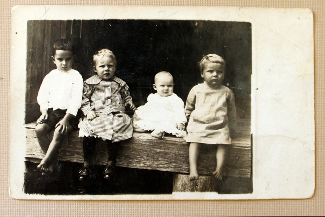 Various relatives including the round face and blonde head of my Grampie at the end of the row.