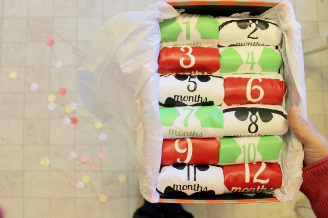 12 onesies- 0 to 12 months, prewashed